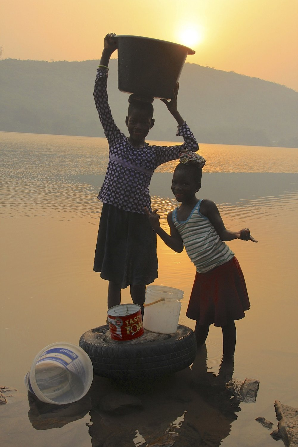 Local girls getting water in the morning from the River Volta