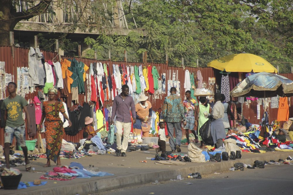 After hours, the streets of Kumasi turn into one huge open market.  Recycled clothing from Europe and the USA is everywhere.