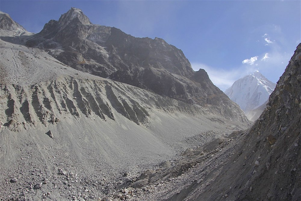 Descending to the Langshisa Glacier on loose, unstable and steep moraine.
