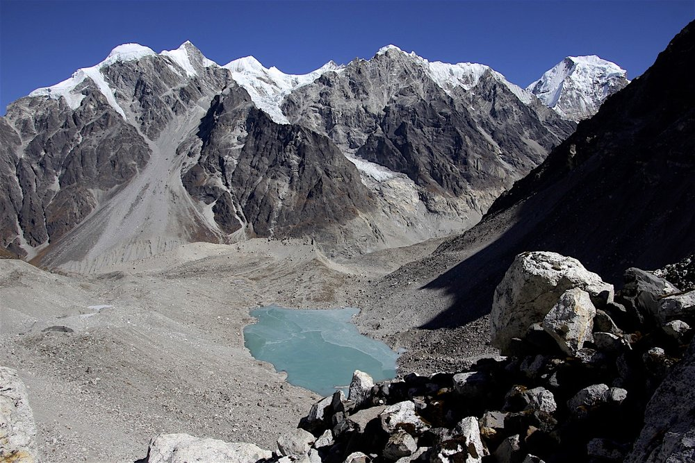 The high camp was by the frozen lake. Mount Langshisa Ri and Langshisa Glacier are behind the lake.
