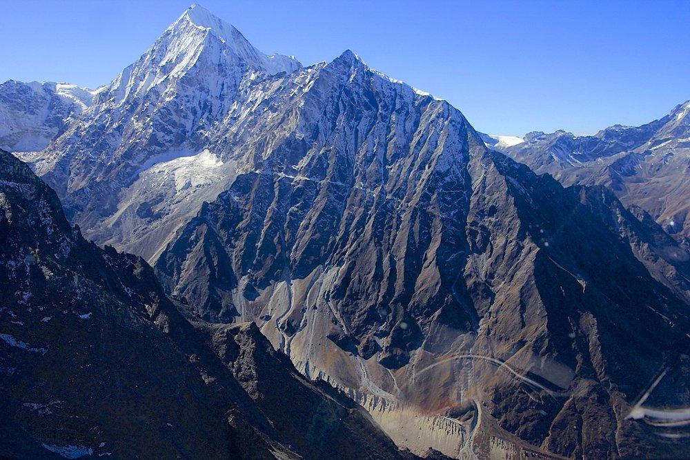 Langshisa Glacier and Ganchempo Peak.