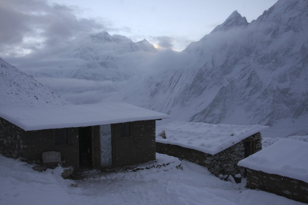 Dharmasala - Larkya Pass basecamp at 4,500m at sunrise.  We got snowed at and the entire world turned white overnight.