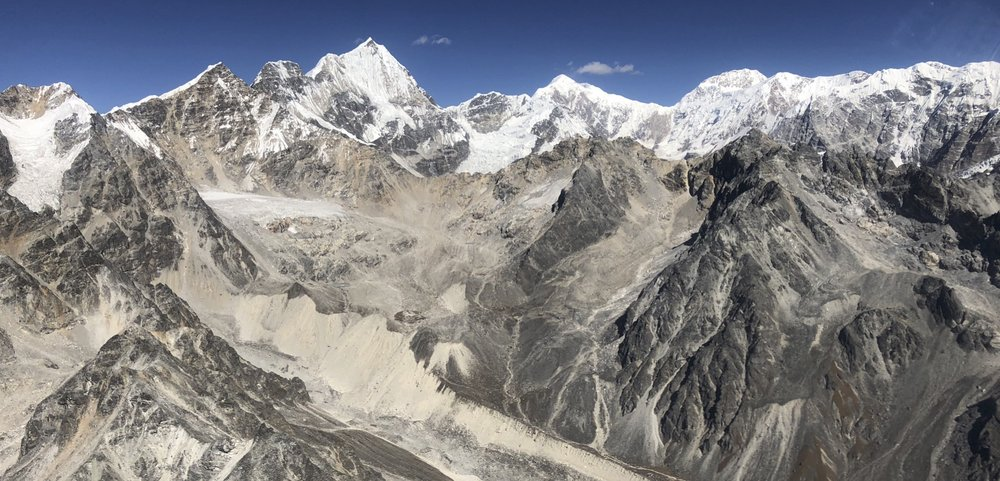 Looking northwest from 19,000 feet. The point peak is Mt. Chusmdo 6,508 in Tibet (China).