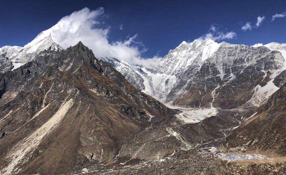 Hiking to the Ganjala Pass with Kinjang Gompa below.