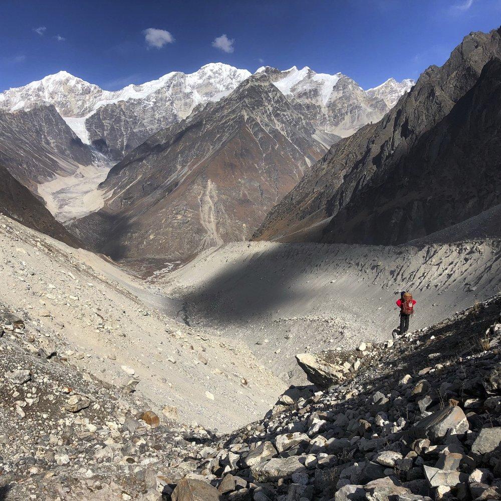 Looking for safe descent to Langshisa Glacier. Langtang River Valley is below.