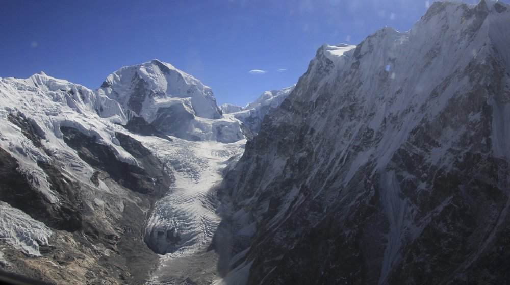 Mt. Dorje Pahad 6,979m at the end of the glacier. The wall of Mt. Langhisa Ri on the right.