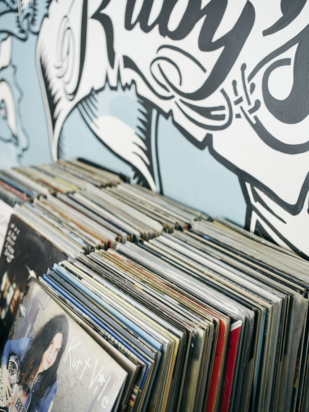 VINYL  Alright, so this is actually more of a life long love/obsession, rather than a current interest. The tunes you hear at the Diner are all playing from owner Ed Devlin's incredible, diverse and ever-expanding record collection. Ask us what's new, but please don't ask us to turn it down.