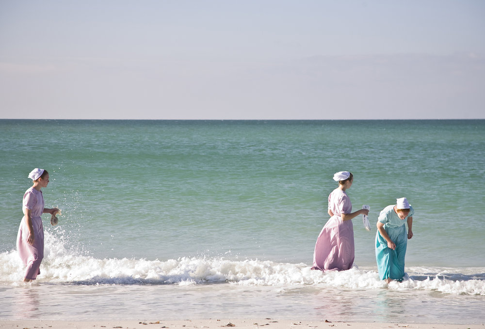 Mennonite ladies collecting shells.