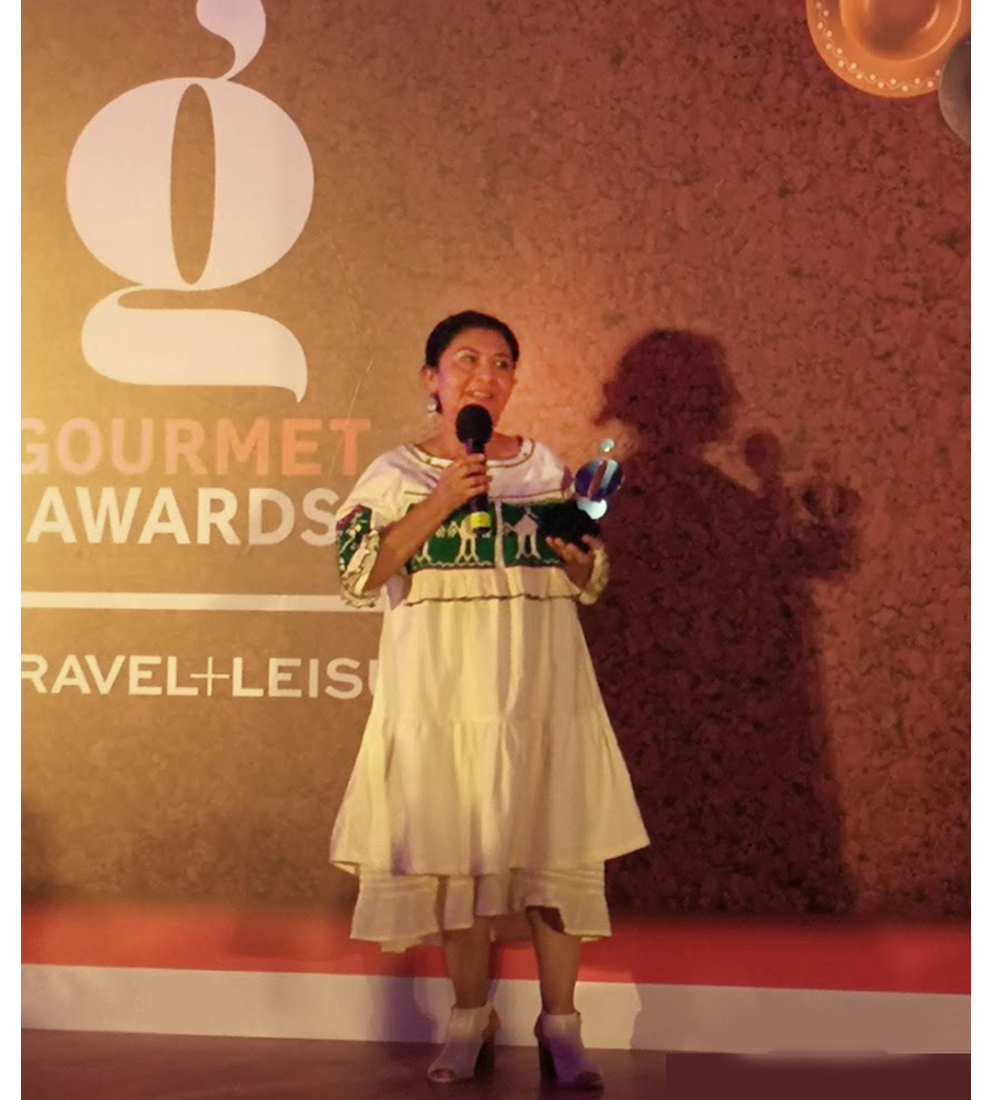 Chef Celia Florian of Oaxaca's Las Quince Letras and CDMX' Pasillo de Humo takes a trophy