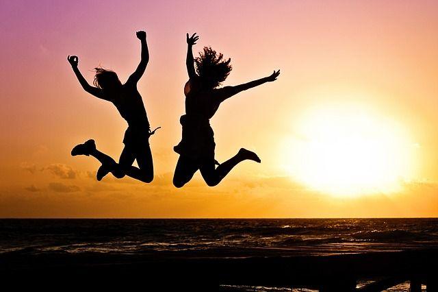 Girls Jumping During Sunset