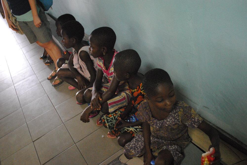 Waiting at the Accra airport. L-R: Kate's legs, Dina, God's Way, Lucky, Sarah Jr., and Gloria.