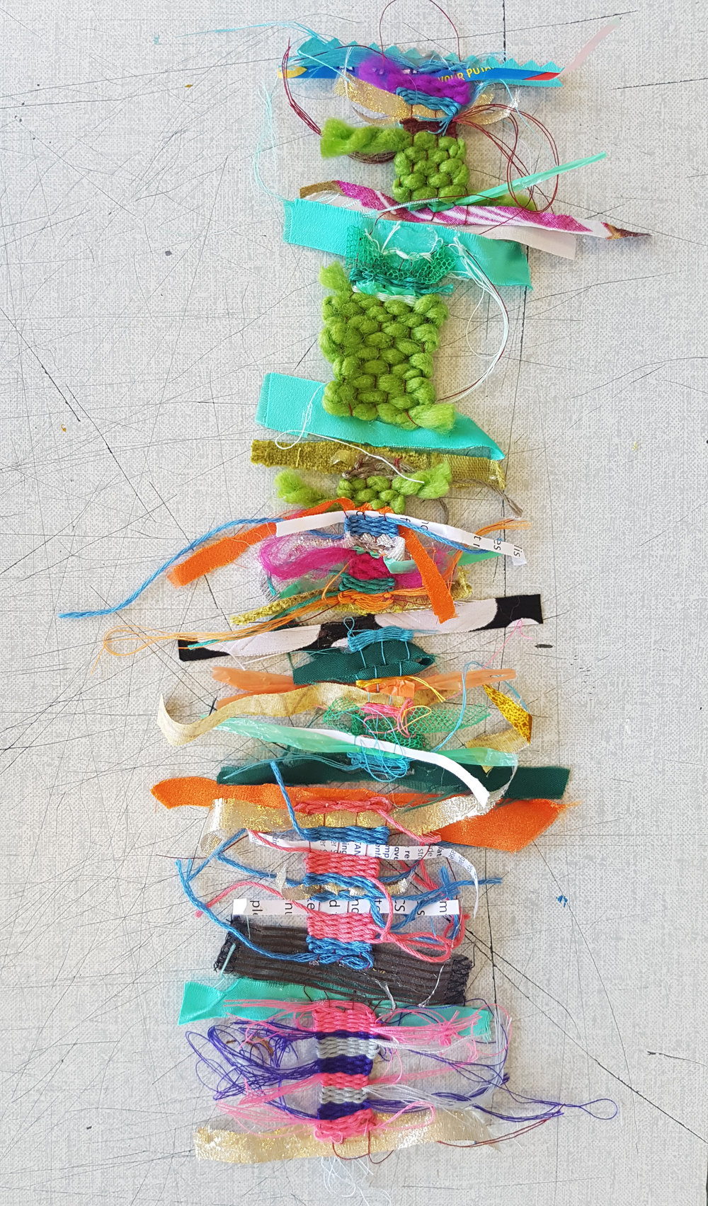 Collaborative matchbox weaving project using recycled materials and experimenting with textures.