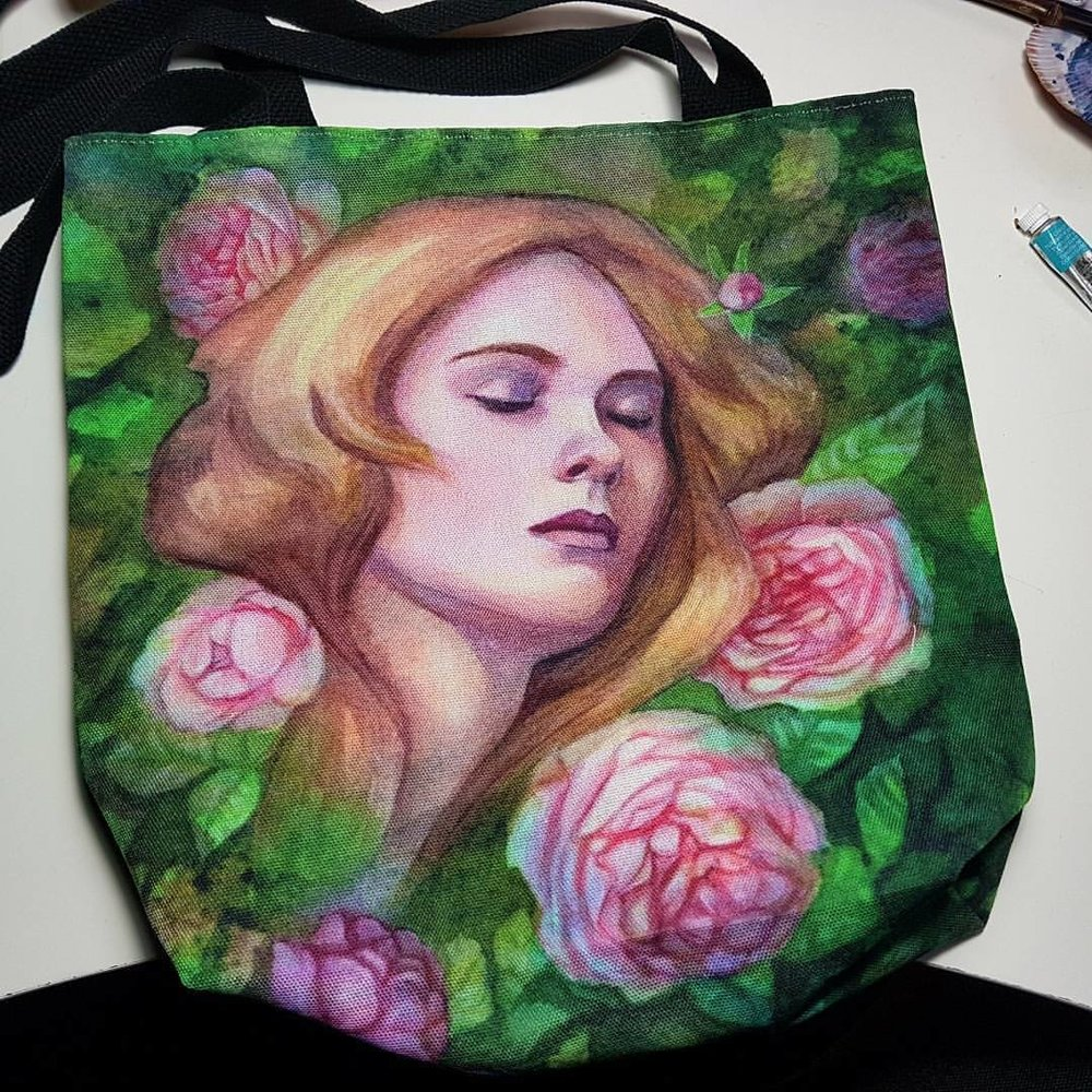 I ordered a bag with my art on it from Redbubble and man did they do a great job! If you want your very own bag enter this link into your browser  https://www.redbubble.com/people/artybel/works/27656761-sleeping-beauty  There is also a discount available of 20% site wide if you enter FINDIT20 in checkout 😁
