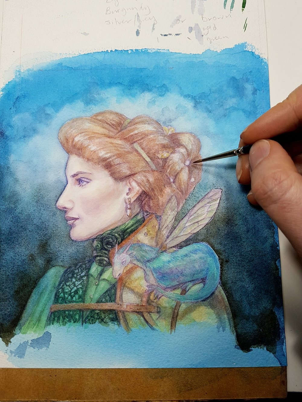 Slowly, slowly does it… when watercolour glazing slow is best. And yay clouds! I wasn't sure what to do with the background until I started looking up some portrait miniatures from the 19th Century. Next thing to tackle is the Fairy Dragon 😁