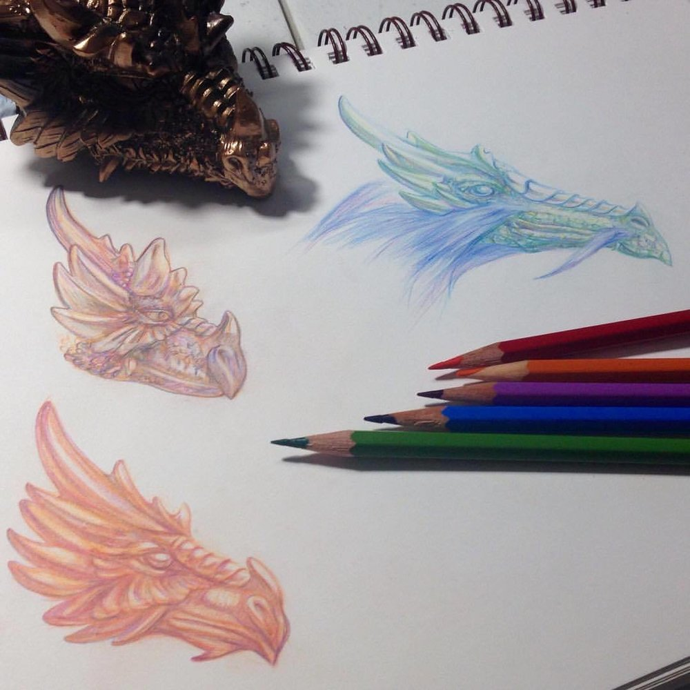 Working on some dragon head ideas for the Warriors and Amazons: a tribute to Boris Vallejo and Julie Bell Artorder Challenge ☺️ #dragons #2015 #belindaillustrates #pencil #prismacolor #colerasepencil #colerasepencils #bluedragon #orangedragon #purpledragon #artorder #artorderchallenge #inspiredbyBorisVallejoJulieBel