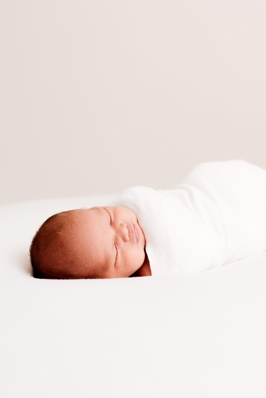 sleeping baby on white