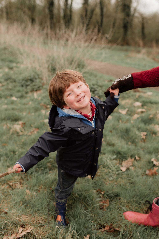 Happy boy holding Mums hand