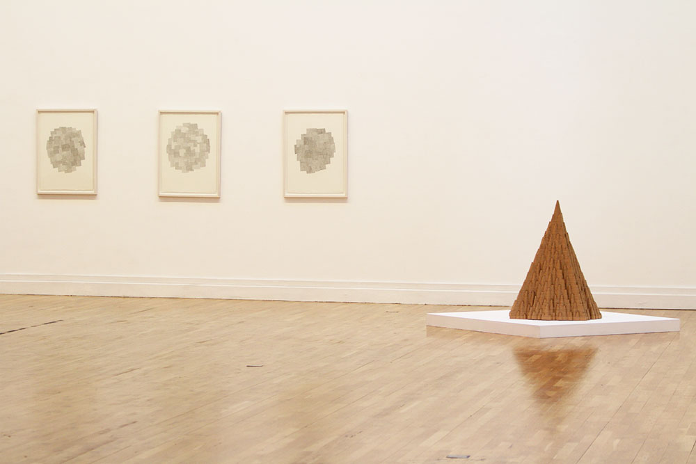 installation view of cardboard sculptures and drawings