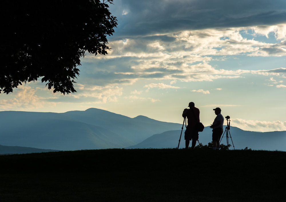 The Photographers - Nikon D7100, 1/640 @ f/8.0, ISO250, 80mm. This was shot from the grounds of Olana overlooking the Hudson River and the Catskill Mountains. Although we were there to shoot the sunset, I was intent on capturing my fellow photographers at work and in silhouette.