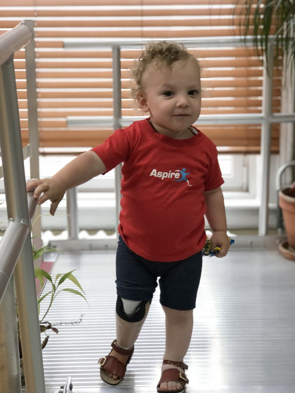 David - A congenital transtibial amputee. ASPIRE has provided several prosthetic legs for David as he progresses through his developmental stages, allowing him to learn how to walk.