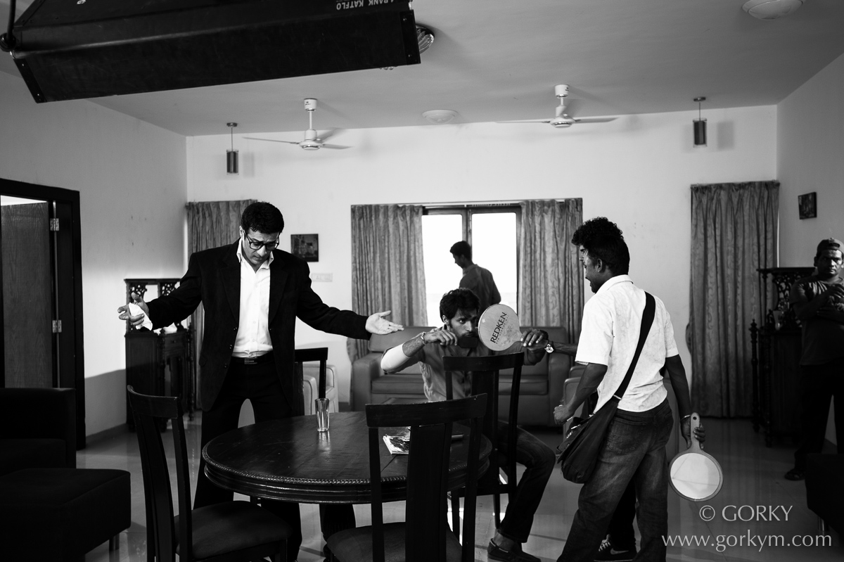Just before a shot - Sachin Verma rehearses his lines and actions while Shaleen Malhotra puts his hair in place.