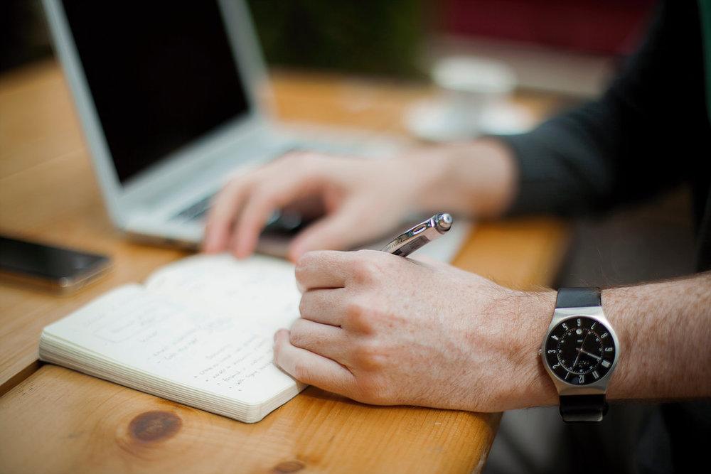 Person writing wearing a watch.jpg