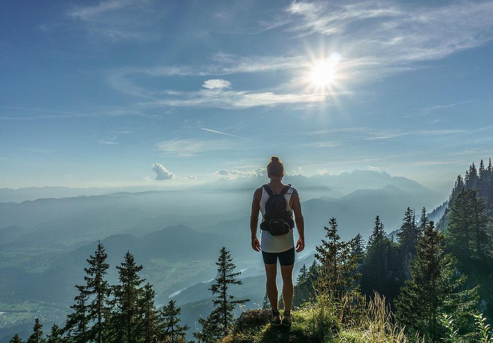 Man on hilltop with sunshine.jpg