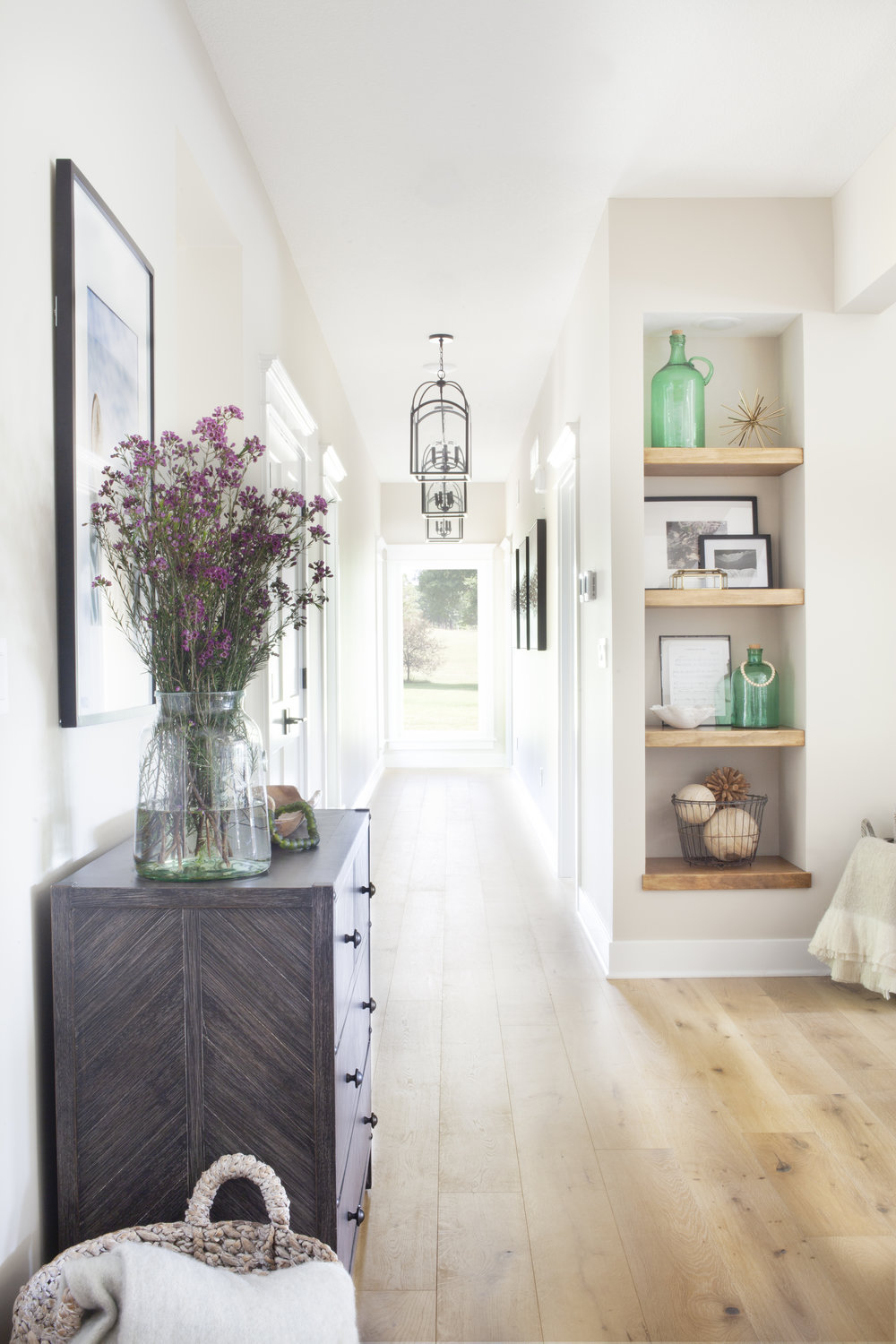 We loved seeing the transformation of our  #SNLakeview  project over time, especially how this entryway went from dark to beautifully light and airy. If you missed Part I of the full reveal, check out our latest blog post. 📷:  @humans.spaces