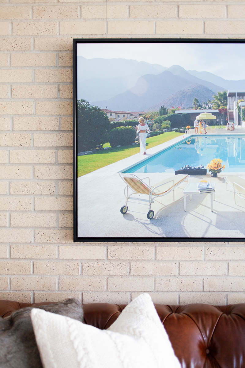 Poolside Glamour print by Slim Aarons. We reserved using saturated color in the rest of the space to really let this piece shine above the leather  Chester Sofa .