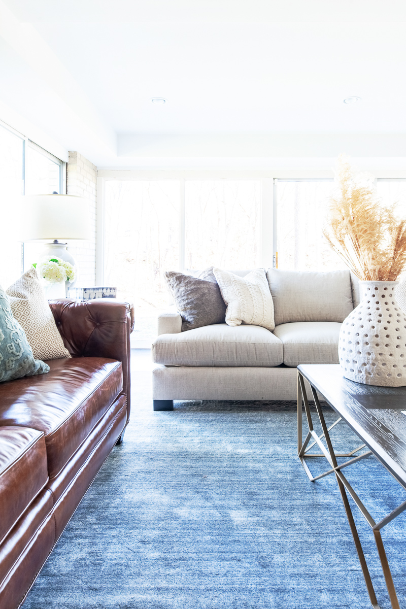 Our client's have such a versatile style, it was important that we brought that through in this living room. One way we did this was by using 3 different styles for seating.