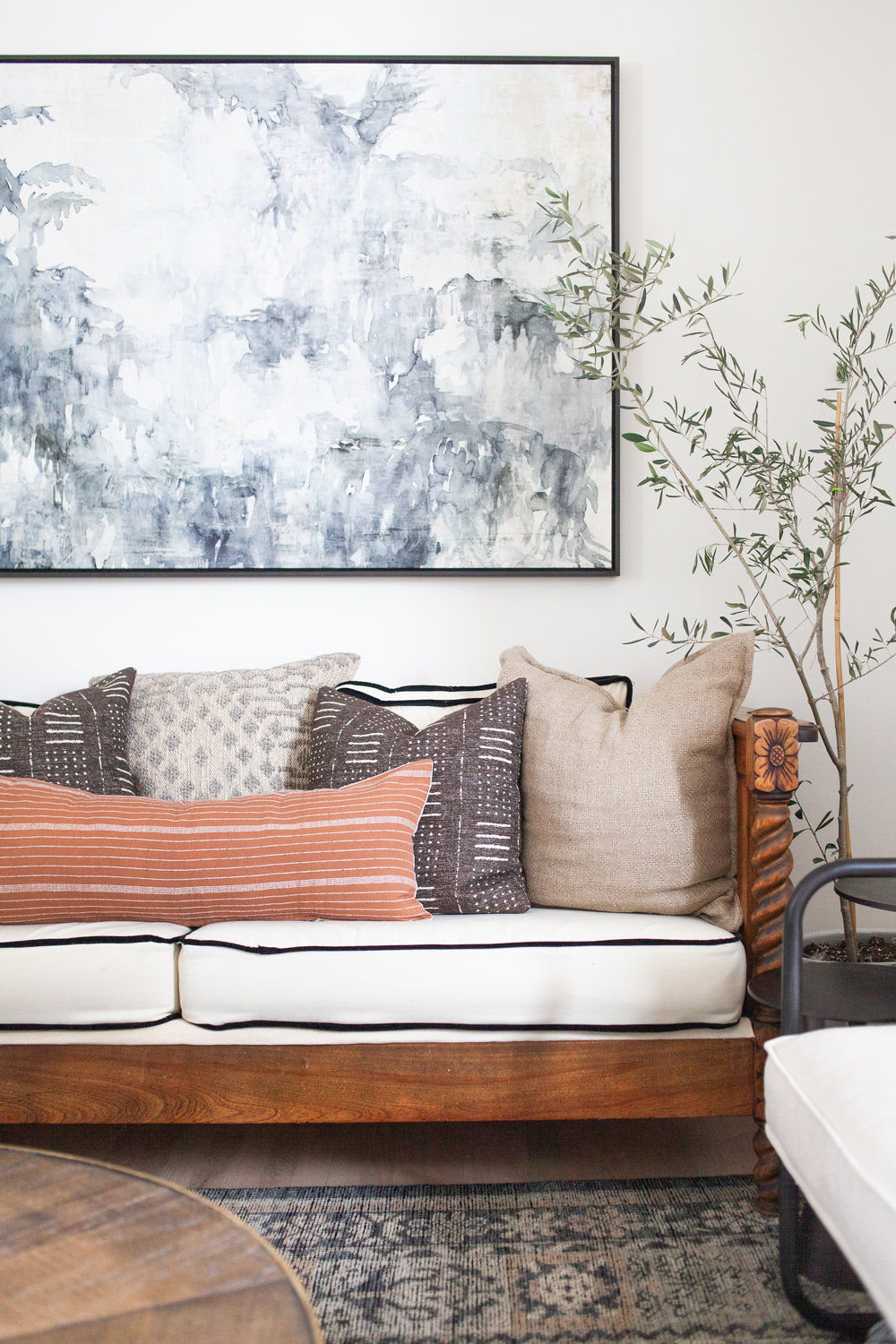 SHOP THE LOOK   |   Pacha Lumbar Pillow in Terra-Cotta    ($250.00),    Taupe Cotton & Wool Pillow    ($119.00),    Bone/Charcoal Heirloom Rug    ($738.00 - $4,018.00),    A Curious Place Framed Artwork    ($462.00)