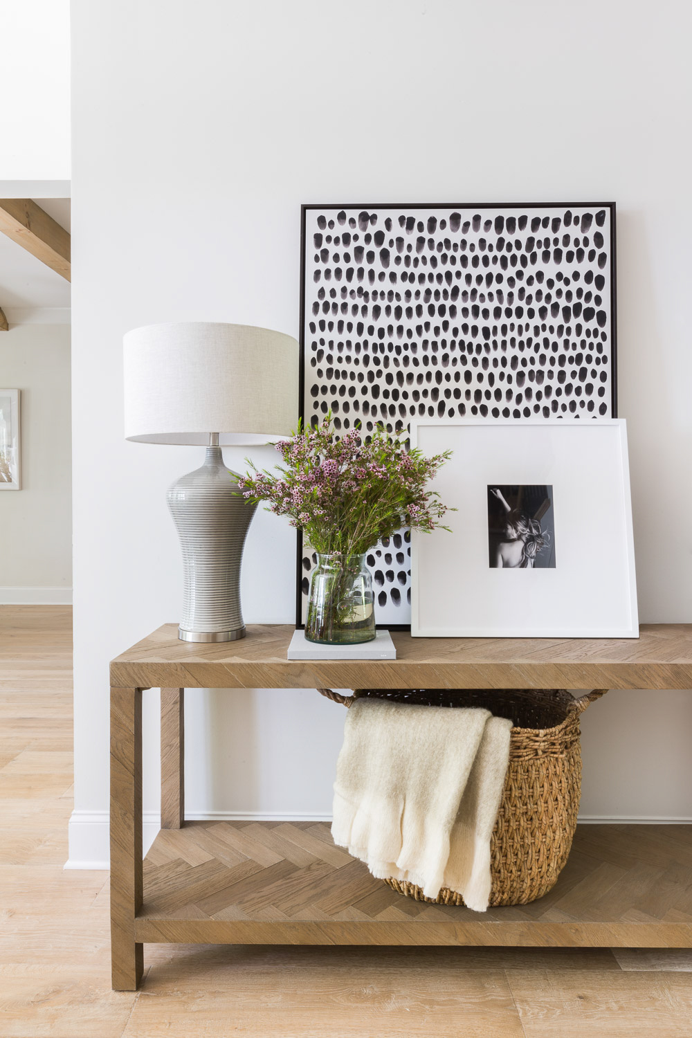 SHOP THE LOOK:   Lamar Console Table ,  Black Dots Framed Artwork ,  Dubrava Table Lamp ,  Medium French Mason Jar ,  Cozy Wool Throw  | Scout & Nimble Design from the  Hilltop Home Project  | Photography by  Alyssa Rosenheck