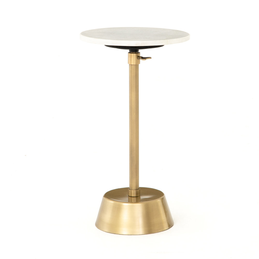Bree Adjustable Accent Table    |  Glamorous yet simple, this slim, adjustable base of brass-finished steel supports a rounded white marble top, perfectly sized to perch a drink. This table is also available in antique pewter.