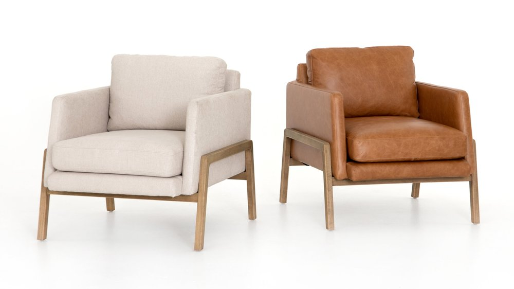 Diana Chair    |      Effortlessly cool. Available in butterscotch top-grain leather and ivory performance-grade fabric, angular track arms complement supple cushioning, with exposed parawood framing delivering the drama.