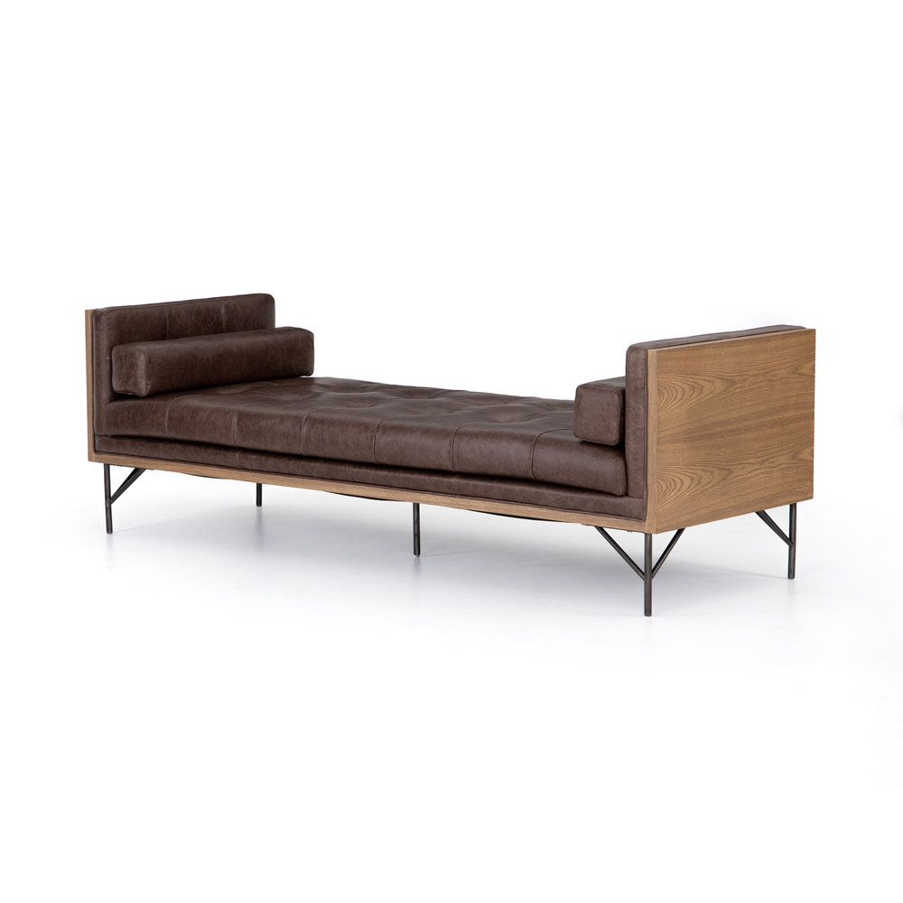 Holden Chaise    |  Mid-century swank modernized by mixed materials. Toasted ash casing contains exclusive top-grain leather, cocoa in color and lightly tufted for comfort. Oxidized iron legs and lumbar pillows for a forward-thinking finishing touch. Also available in Cream Upholstery.
