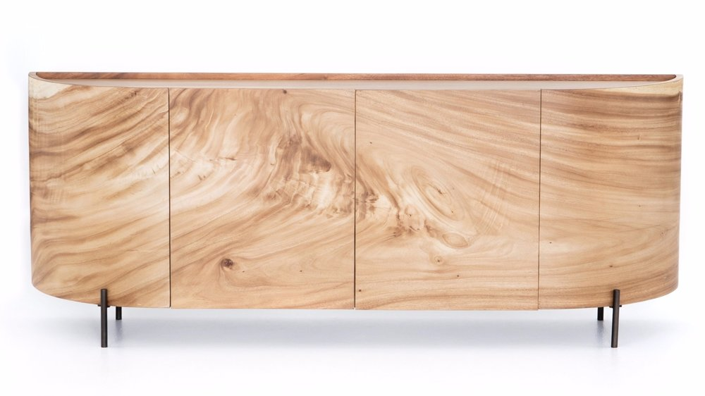 Lunas Sideboard    |  With soft shaping and inset top inspired by classic jewelry setting, gold guanacaste forms a beautifully sculpted silhouette, with natural high and lowlights coursing the entirety of this richly styled sideboard.