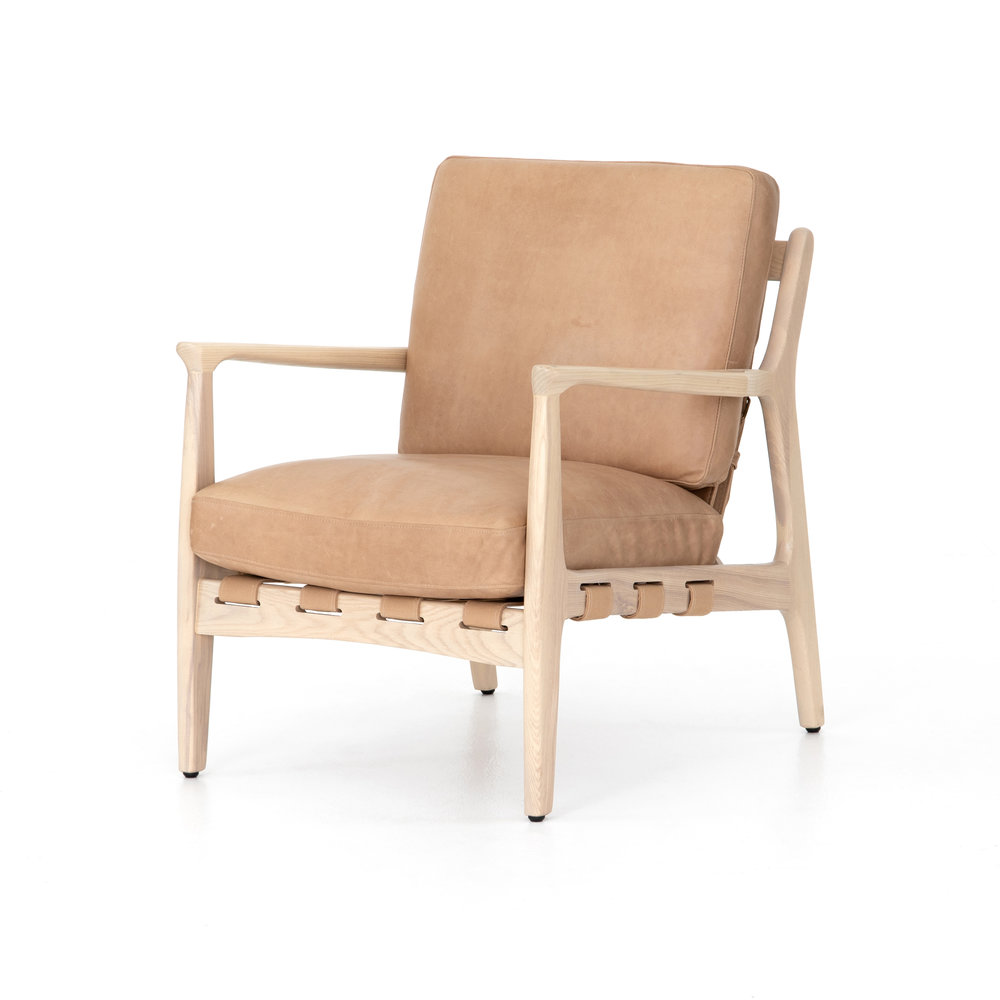 Silas Chair    |  A striking silhouette with design-forward details any way you look at it. Top-grain, hand-finished leather sits in a whitewashed ash frame fastened by parachute strapping made of canvas, leather and metal buckles.