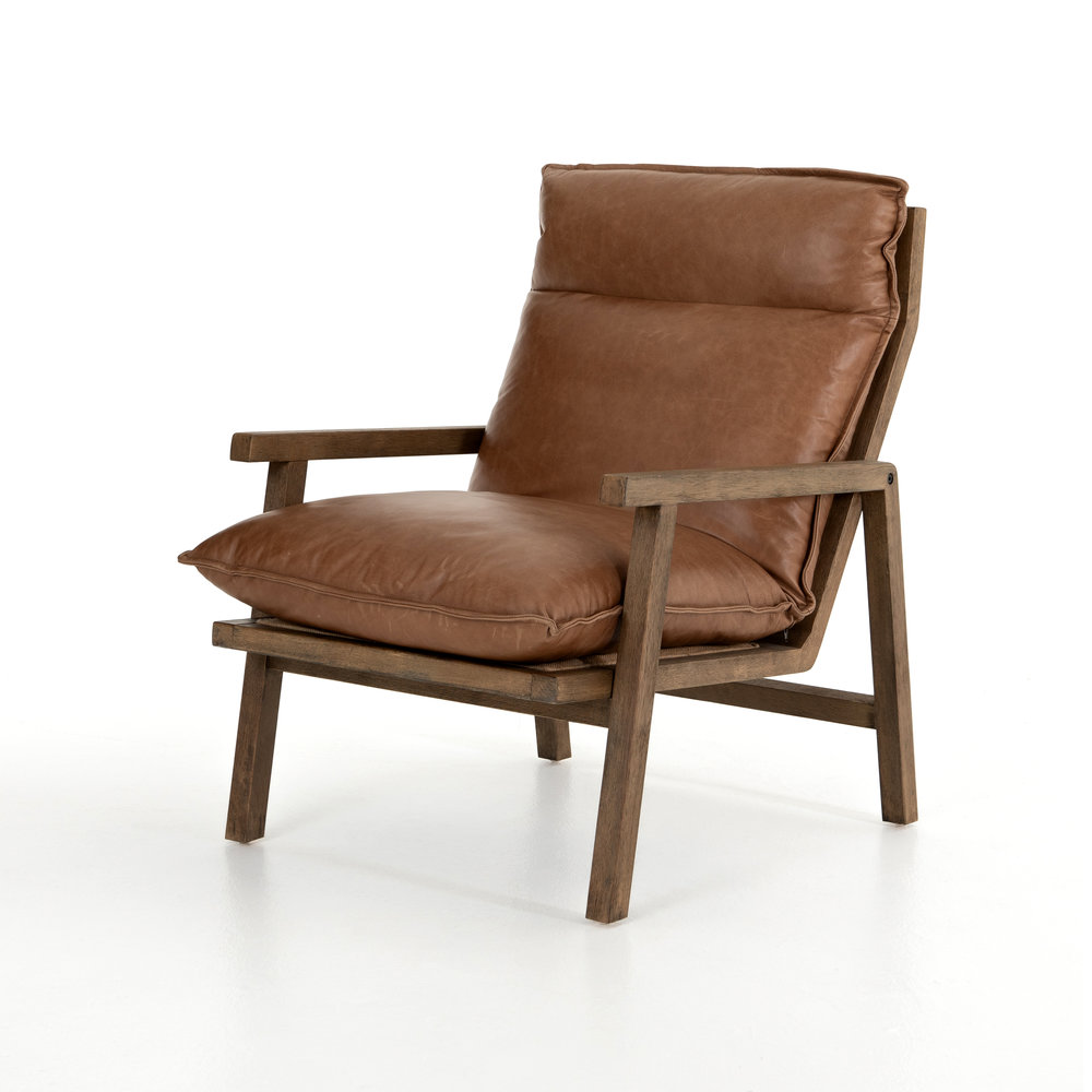 Orion Chair    |  Mid-century modern styles pair perfectly with any space because they blend so seamlessly with traditional and modern. This chair features top-grain leather, a parawood frame, and ladder-back detailing.