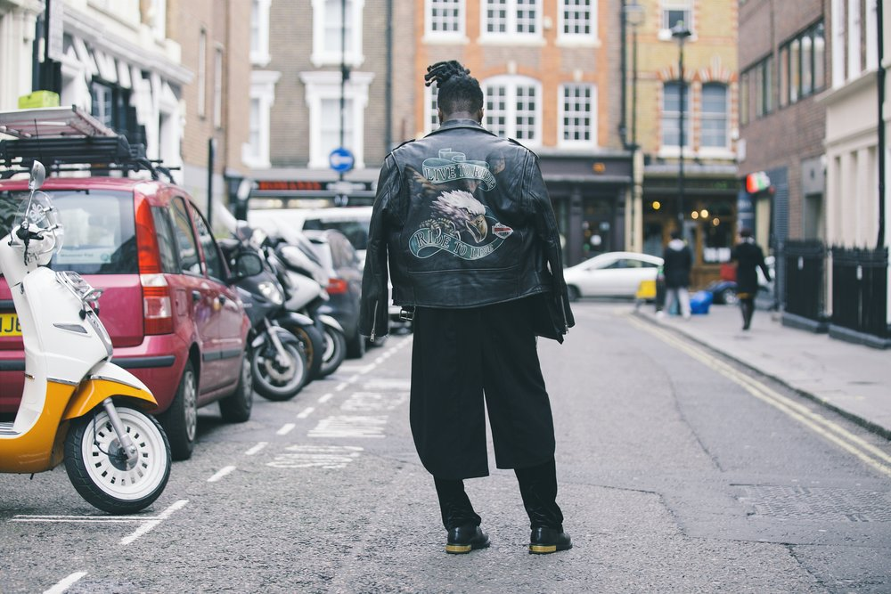 Explore Your Mind: back view of a black man in a London street wearing a leather jacket