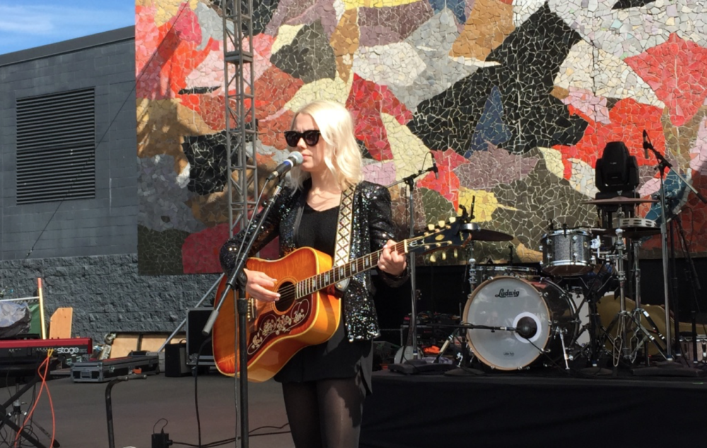 Phoebe performing on the Mural Stage at Bumbershoot.