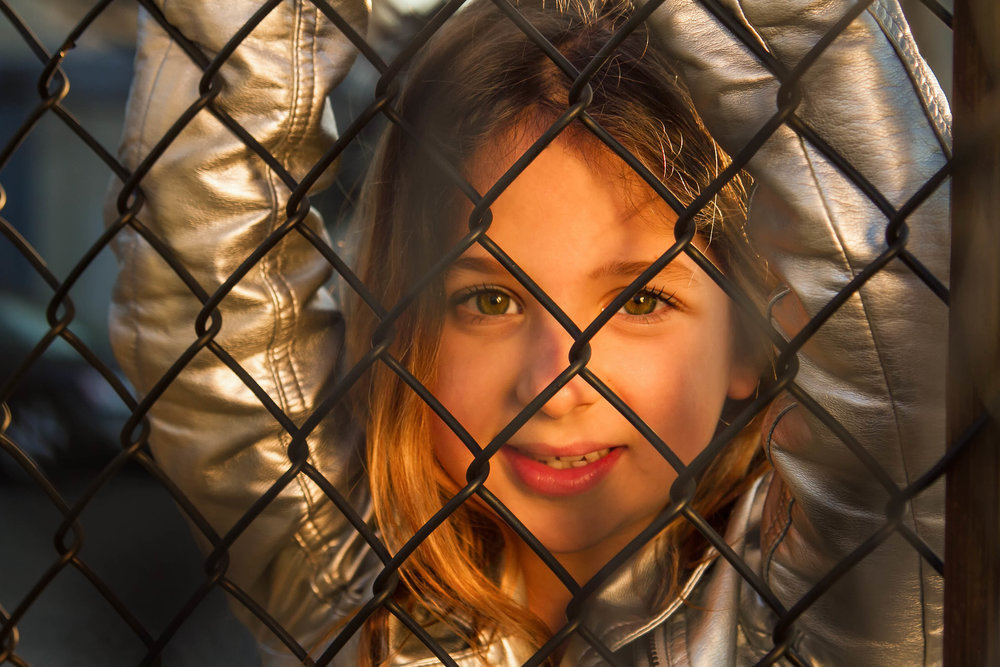 looking through the fence_young girl.jpg