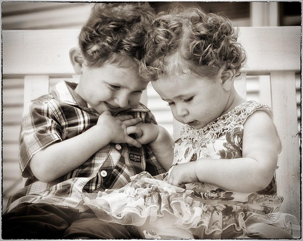 smiling siblings b&w.jpg