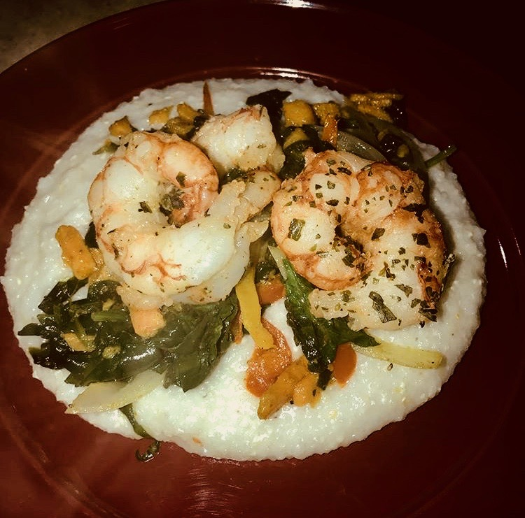 Caribbean-inspired shrimp and grits made with coconut milk and seasoned with curry, peppers and onions.