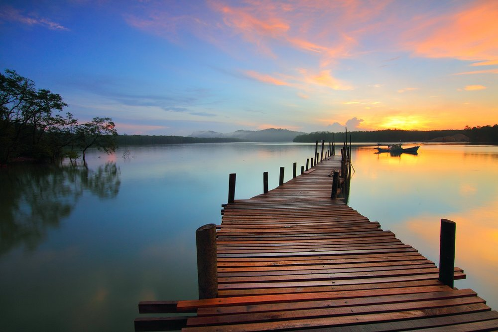 wooden dock with colorful sunset