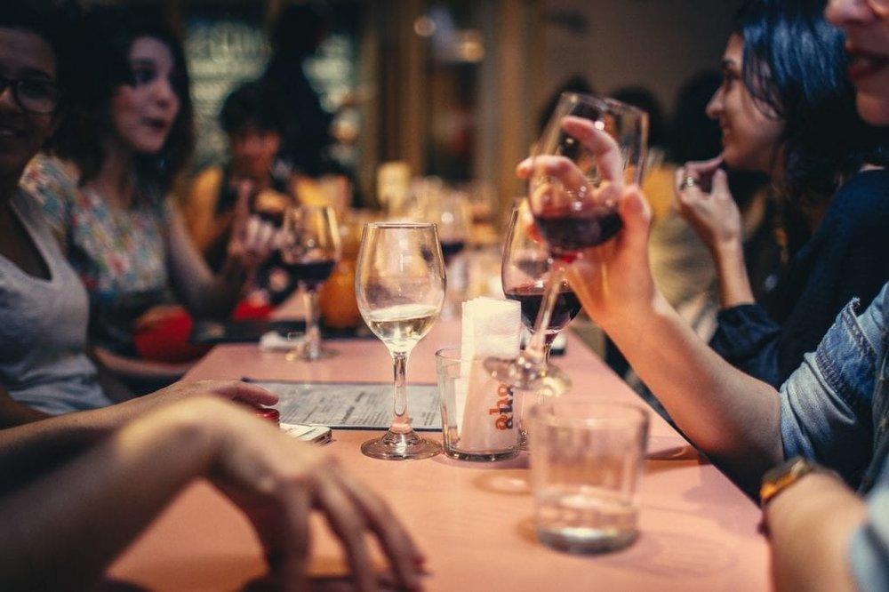 Group of Women Drinking Wine