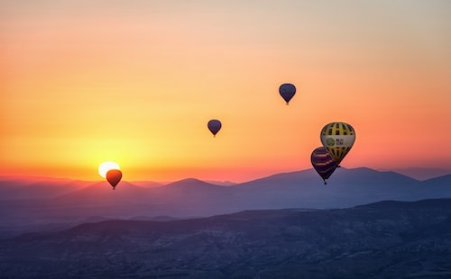 hot air balloons and sunset