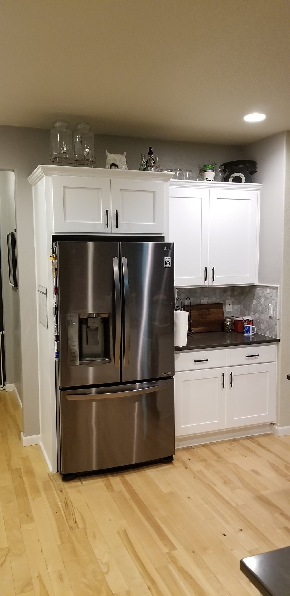 """Updated kitchen using the same existing cabinets, painted with new doors and hardware. """"Now I just open the cabinet to see the soft-close"""""""