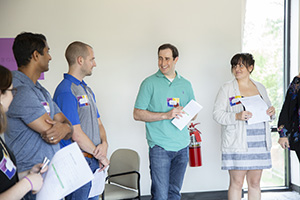 Brian Alvo, center, and Lisa, right, at a NextGen Center event.