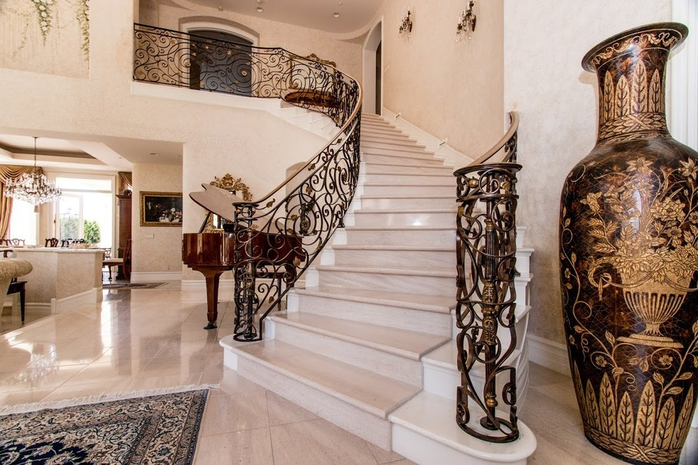 Custom, Hand Forged Orante Staircase railing in Cota De Caza, California