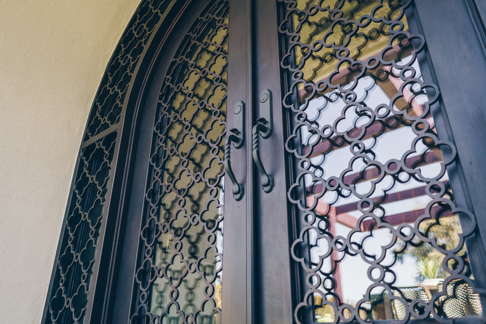 Hand Forged, Tuscany Inspired Designed Iron Door in Costa Mesa, California
